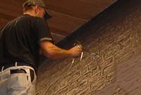 latex spuiten op muur in Groningen